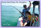 Dad helps his daughter on fat cat fishing charters in st pete fl.