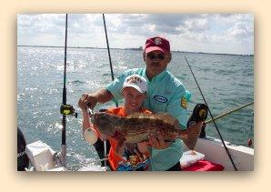 Kids catch Grouper with Capt Jay Masters.